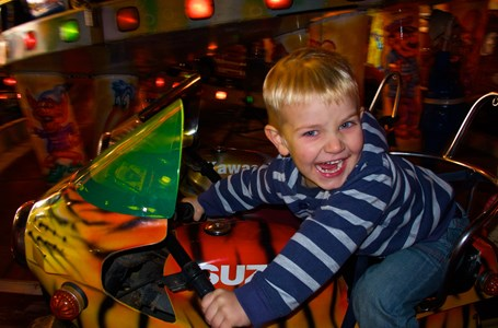 Child On Funfair Motorbike